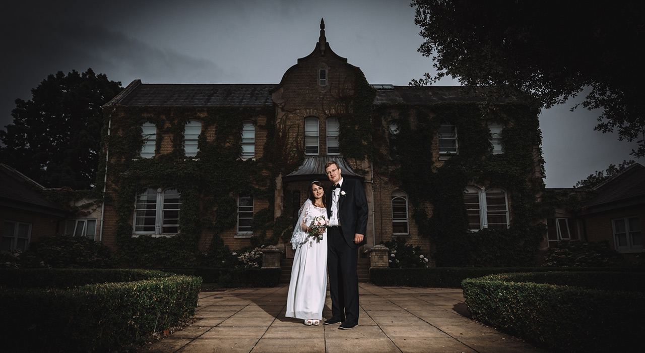 Bridal couple in front of hotel